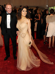 Salma Hayek teamed her peach confection with a champagne Alexander McQueen clutch.
