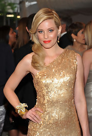 Elizabeth Banks looked golden at the 2011 Met Gala in a one-shoulder sequin dress. She punched up her look with a floral embellished gold cuff.