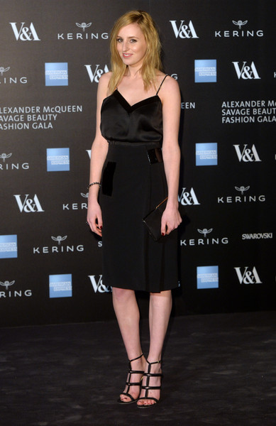 Laura Carmichael dressed up her simple outfit with sexy black gladiator heels.