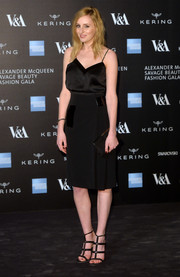 Laura Carmichael chose a black pencil skirt, also by Christopher Kane, to pair with her cami.