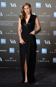 Princess Beatrice looked very refined in a black tuxedo gown by Alexander McQueen during the Savage Beauty exhibition.