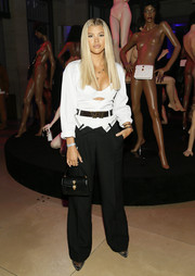 Sofia Richie finished off her ensemble with a black Alexander Wang x Bulgari leather purse.