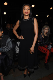 Taraji P. Henson showed off her edgy-chic style with this grommeted LBD by Alexander Wang during the brand's fashion show.