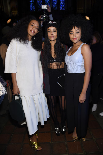 Solange Knowles kept it modest in a loose white knit top at the Alexander Wang fashion show.