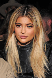 Kylie Jenner sat front row at the Alexander Wang Spring 2016 show wearing her hair in a center-parted layered style.