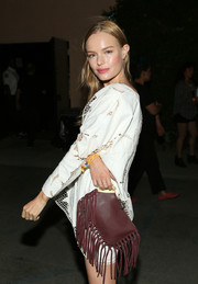 Kate Bosworth went to the Alexander Wang x H&M Coachella party carrying a fringed brown clutch by Tabitha Simmons.