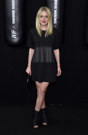 Dakota Fanning wore a pair of black peep toe booties to the Alexander Wang x H&M launch.