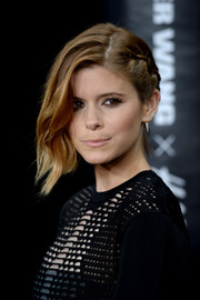 Kate Mara rocked an asymmetric hairstyle with a braid on one side and a wavy combover on the other at the Alexander Wang x H&M launch.