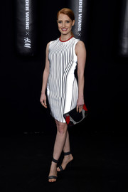 Jessica Chastain wore a white mini dress with vertical stripes to the Alexander Wang x H&M launch.