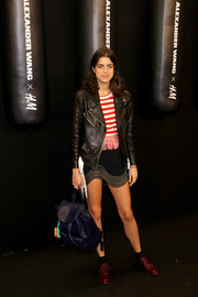 Leandra Medine accessorized her outfit with a purple croc backpack.