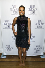 Carmen Ejogo chose a Pamella Roland LBD that was a fun combination of sequins and feathers for her Oscar's Sistahs Soiree look.