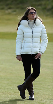 Elizabeth Hurley bundled up in a chic puffa coat for a day out on the green.