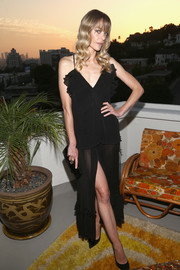 Jaime King donned an alluring black ruffle camisole by Alice McCall for the label's SS18 launch.