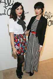 Lisa Origliasso wore a white button-down shirt to match her colorful skirt.