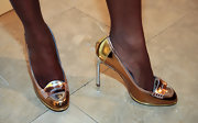 Tika Sumpter shimmered in a pair of gold and silver pumps at the Alice + Olivia fashion show.