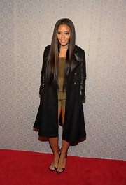 Angela Simmons gave her look a rocker vibe with a black trenchcoat with leather trim.