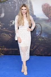 Tallia Storm completed her stylish ensemble with a pair of nude lace-up heels.