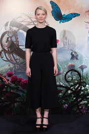Mia Wasikowska rounded out her all-black look with a pair of platform sandals.
