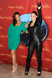 Alicia Keys struck a pose with her new wax figure in a pair of nude patent double criss cross Vamp sandals.