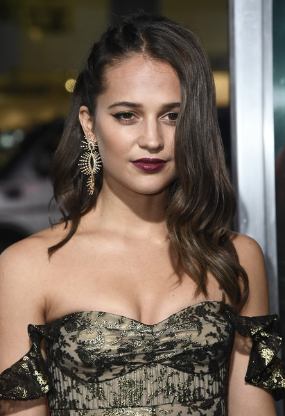 Alicia Vikander Berry Lipstick [tomb raider,hair,face,hairstyle,fashion model,shoulder,beauty,eyebrow,lip,long hair,fashion,arrivals,alicia vikander,california,hollywood,tcl chinese theatre,warner bros. pictures,premiere]