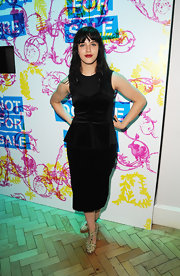 This black knee-length dress with slight peplum detailing was perfectly fit and elegant on Jessica Brown-Findlay.