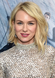Naomi Watts was all about easy glamour with her asymmetrical waves at the New York premiere of 'Allegiant.'