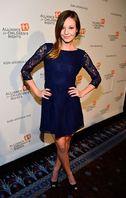 Samantha Droke looked pretty in lace in this navy blue dress with long sleeves.