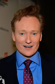 Conan O'Brien opted for a cranberry and pale blue geometric tie for his evening look.