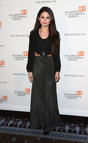 Selena Gomez looked hippie-chic in this black and gray maxi dress with slit sleeves and cutout waist.