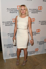 Malin Akerman teamed her dress with sexy-chic gray strappy sandals.