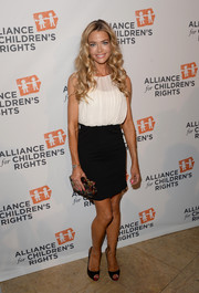 Denise Richards paired her blouse with a black mini skirt for a totally girly-chic look.