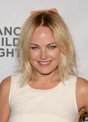 Malin Akerman went for edgy styling with this center-parted layered 'do during the Alliance for Children's Rights dinner.