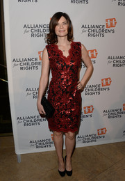 Betsy Brandt complemented her dress with a chic beaded black clutch.