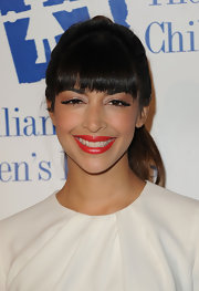 Hannah Simone attended the Alliance for Children's Rights Annual Dinner wearing her hair in a high wrapped ponytail.