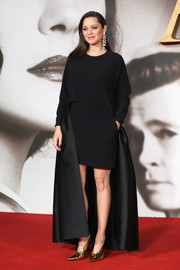 Marion Cotillard injected some shine with a pair of mirrored gold pumps, also by Stella McCartney.