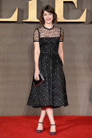 Lizzy Caplan went sweet in a dotted, lace-panel cocktail dress by Elie Saab for the UK premiere of 'Allied.'