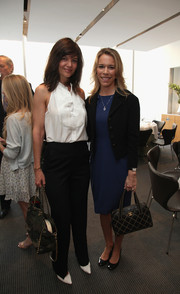 Katie Holmes paired a white halter top with black slacks for a casual-chic look at Allison Pataki's book launch.