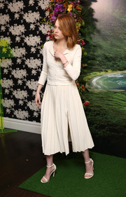 Emma Stone added a girly touch with a pleated, high-slit skirt, also by Brook Collection.