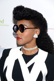 Janelle Monae wore her hair in a ponytail (with her signature puff bangs) for the Power Up Gala.