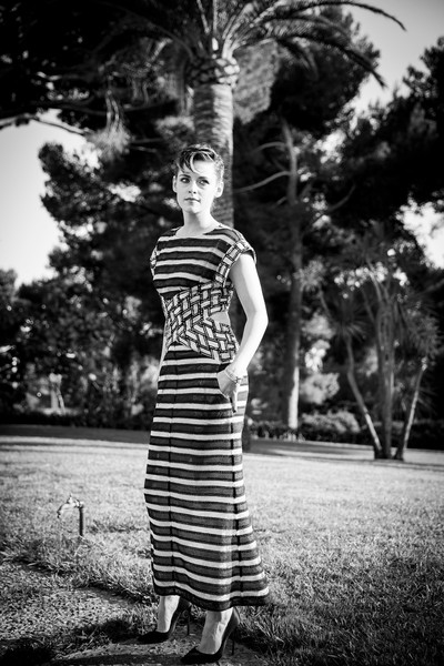 Kristen Stewart looked effortlessly chic in a striped cutout dress by Chanel at the amfAR Gala Cannes 2018.