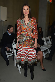 Wendi Deng's metallic purse almost blended with her print dress at the Altuzarra fashion show.