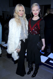 Rachel Zoe looked '70s-glam at the Altuzarra fashion show in a white fur coat, a silver tie-neck blouse, and black bell-bottoms.