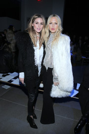 Olivia Palermo teamed a black fur vest with a white button-down and leather skinnies for the Altuzarra fashion show.