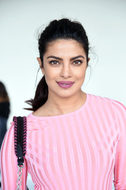 Priyanka Chopra brushed her hair back into a simple ponytail for the Altuzarra fashion show.
