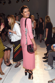 Priyanka Chopra paired a two-tone suede shoulder bag with a pink sweater dress, both by Altuzarra, for the label's fashion show.
