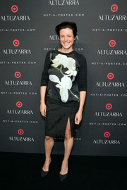 Showing support for the brand, Garance Dore wore this Altuzarra for Target orchid-print sweatshirt during the collaboration's launch.