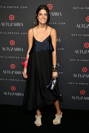 Leandra Medine showed some skin in a low-cut spaghetti-strap LBD during the Altuzarra for Target launch.
