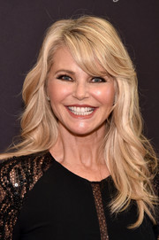 Christie Brinkley looked summer-glam with her blonde waves and side-swept bangs at the premiere of 'Always at the Carlyle.'