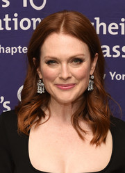 Julianne Moore added an ultra-glam touch with a pair of diamond chandelier earrings.