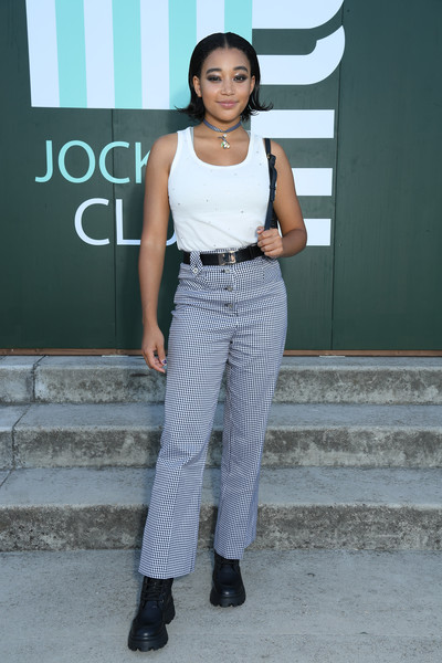 Amandla Stenberg Tank Top [clothing,white,fashion,street fashion,waist,jeans,fashion design,shoulder,trousers,footwear,amandla stenberg.,miu miu club,miu miu,hippodrome dauteuil,paris,france,club event]